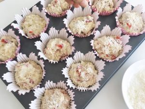 Coconut muffins with raspberries add coconut topping