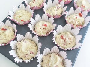 Coconut muffins with raspberries add to cases
